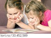Купить «Two adorable little happy sisters are reading a book in their room.», фото № 33452589, снято 6 февраля 2020 г. (c) Акиньшин Владимир / Фотобанк Лори