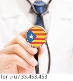 National flag on stethoscope conceptual series - Estelada - Catalonia - Spain. Стоковое фото, фотограф Zoonar.com/Siarhei Tsalko / age Fotostock / Фотобанк Лори