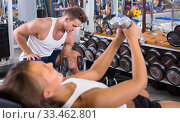 Купить «Young sports man making biceps curls in gym», фото № 33462801, снято 7 июня 2020 г. (c) Яков Филимонов / Фотобанк Лори