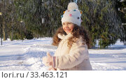 Купить «happy little girl throwing snow in winter park», видеоролик № 33463121, снято 9 марта 2020 г. (c) Syda Productions / Фотобанк Лори