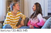 Купить «teenage girl giving present to her friend at home», видеоролик № 33463145, снято 6 марта 2020 г. (c) Syda Productions / Фотобанк Лори
