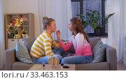 Купить «happy teenage girls doing make up at home», видеоролик № 33463153, снято 6 марта 2020 г. (c) Syda Productions / Фотобанк Лори