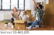 Купить «happy family playing with foam peanuts at new home», видеоролик № 33463205, снято 22 марта 2020 г. (c) Syda Productions / Фотобанк Лори