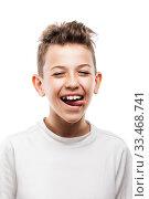 Купить «Funny toothy smiling handsome teenager boy showing tongue white isolated», фото № 33468741, снято 30 мая 2019 г. (c) Илья Андриянов / Фотобанк Лори