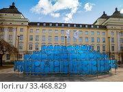 "Tallinn, Estonia - MAR 14, 2020: The symbols ""Estonia 100"" in Tammsaare Park at Estonia Kontserdisaal. Редакционное фото, фотограф Юлия Кузнецова / Фотобанк Лори"