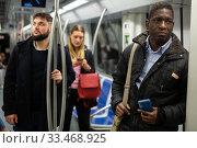 Купить «People in metro train», фото № 33468925, снято 8 апреля 2020 г. (c) Яков Филимонов / Фотобанк Лори