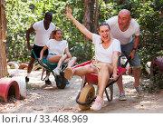 Купить «Group of people at adventure park», фото № 33468969, снято 6 августа 2020 г. (c) Яков Филимонов / Фотобанк Лори