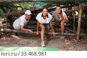 Купить «People passing obstacles at adventure park», фото № 33468981, снято 6 августа 2020 г. (c) Яков Филимонов / Фотобанк Лори