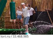 Friends are looking for adventure in an amusement park. Стоковое фото, фотограф Яков Филимонов / Фотобанк Лори