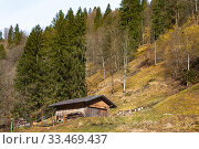 Купить «Rural barn and shed with mountains behind on sunny day», фото № 33469437, снято 20 февраля 2020 г. (c) Papoyan Irina / Фотобанк Лори