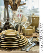 Купить «Set of dishes on table», фото № 33469777, снято 5 августа 2016 г. (c) Ольга Сергеева / Фотобанк Лори