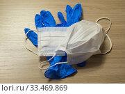 Медицинские маски и латексные перчатки - защита от коронавируса. Стоковое фото, фотограф Кузин Алексей / Фотобанк Лори