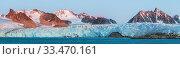 Купить «Stitched panorama of the Smeerenburgbreen Glacier at sunset. Mountains viewed from Smeerenburgfjorden / Bjornfjorden. Svalbard, Norway. September.», фото № 33470161, снято 2 апреля 2020 г. (c) Nature Picture Library / Фотобанк Лори