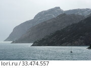 Купить «Sail Boat Navigating Through The Norwegian Fjords», фото № 33474557, снято 2 апреля 2020 г. (c) easy Fotostock / Фотобанк Лори