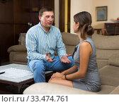 Man enjoying conversation with woman. Стоковое фото, фотограф Яков Филимонов / Фотобанк Лори