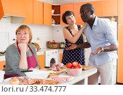Купить «Dissatisfied elderly woman during quarrel with daughter and her husband», фото № 33474777, снято 17 августа 2019 г. (c) Яков Филимонов / Фотобанк Лори