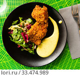Купить «Chicken tandoori in panko with mousseline sauce», фото № 33474989, снято 3 апреля 2020 г. (c) Яков Филимонов / Фотобанк Лори