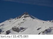 Купить «Beautiful mountains covered with snow. Sunny day and blue sky on a frosty day», фото № 33475081, снято 5 марта 2019 г. (c) Олег Хархан / Фотобанк Лори