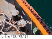 Купить «Bollard and ropes are on a tug boat deck», фото № 33475121, снято 26 декабря 2019 г. (c) EugeneSergeev / Фотобанк Лори