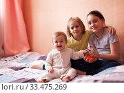 Купить «girls of eight, seven and one-year-old», фото № 33475269, снято 8 апреля 2020 г. (c) Дарья Филимонова / Фотобанк Лори