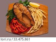 Купить «Fish steak with salad high angle shot», фото № 33475861, снято 2 апреля 2020 г. (c) Гурьянов Андрей / Фотобанк Лори