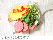Купить «Omelet with sausage and arugula on a white wooden background», фото № 33476017, снято 2 апреля 2020 г. (c) Марина Володько / Фотобанк Лори