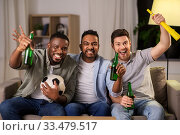 Купить «friends or soccer fans with ball and beer at home», фото № 33479517, снято 28 декабря 2019 г. (c) Syda Productions / Фотобанк Лори