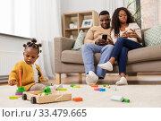 Купить «african baby girl playing with toy blocks at home», фото № 33479665, снято 29 сентября 2019 г. (c) Syda Productions / Фотобанк Лори