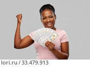 Купить «happy african american woman with dollar money», фото № 33479913, снято 26 января 2020 г. (c) Syda Productions / Фотобанк Лори