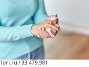 Купить «woman cleaning hands with antiseptic wet wipe», фото № 33479981, снято 13 марта 2020 г. (c) Syda Productions / Фотобанк Лори