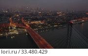 Купить «Swietokrzyski bridge over the Vistula river at night. Warsaw, Poland», видеоролик № 33480429, снято 1 июня 2020 г. (c) Яков Филимонов / Фотобанк Лори