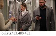 Купить «Two women passengers talking in subway car on way to work», видеоролик № 33480453, снято 11 ноября 2019 г. (c) Яков Филимонов / Фотобанк Лори