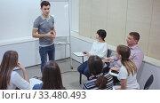 Купить «Male manager making presentation on staff meeting in office», видеоролик № 33480493, снято 5 апреля 2020 г. (c) Яков Филимонов / Фотобанк Лори