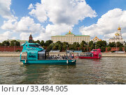 Купить «Two modern green and red tourist boats floating on the Moscow river against the background of the Moscow Kremlin. Moscow, Russia», фото № 33484905, снято 8 августа 2019 г. (c) Наталья Волкова / Фотобанк Лори