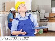 Male contractor determining scope of work. Стоковое фото, фотограф Яков Филимонов / Фотобанк Лори