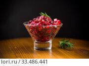 Купить «salad boiled vegetables salad on a wooden table», фото № 33486441, снято 5 апреля 2020 г. (c) Peredniankina / Фотобанк Лори