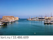 Купить «View of the medieval sea fortress Coules and the old port on a sunny summer day. Heraklion, Crete, Greece», фото № 33486609, снято 5 июня 2017 г. (c) Наталья Волкова / Фотобанк Лори