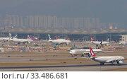 Купить «Airplane departure from International Airport, Hong Kong», видеоролик № 33486681, снято 10 ноября 2019 г. (c) Игорь Жоров / Фотобанк Лори