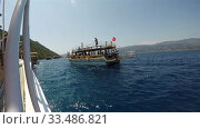 Купить «Gulets with tourists on Board sail to the shores of Turkey», видеоролик № 33486821, снято 26 августа 2019 г. (c) Aleksandr Sulimov / Фотобанк Лори