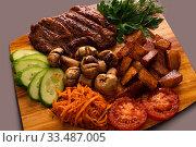 Купить «Shashlyk with vegetables and carrot salad shot», фото № 33487005, снято 28 января 2020 г. (c) Гурьянов Андрей / Фотобанк Лори