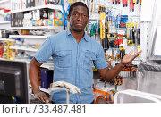 Купить «Attentive salesman working on computer», фото № 33487481, снято 21 января 2019 г. (c) Яков Филимонов / Фотобанк Лори