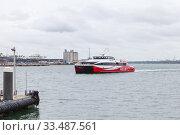 Купить «Fast passenger ferry arrives the port of Southampton», фото № 33487561, снято 24 апреля 2019 г. (c) EugeneSergeev / Фотобанк Лори