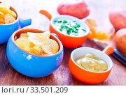 Купить «Potato chips with sauce on a table», фото № 33501209, снято 10 июля 2020 г. (c) age Fotostock / Фотобанк Лори