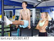 Купить «Man doing push-ups with trainer», фото № 33501417, снято 16 июля 2018 г. (c) Яков Филимонов / Фотобанк Лори