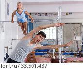 Man and woman doingexercises on floor. Стоковое фото, фотограф Яков Филимонов / Фотобанк Лори