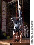 Купить «Young woman in ripped jeans performing pole dance», фото № 33501505, снято 6 июля 2020 г. (c) Яков Филимонов / Фотобанк Лори