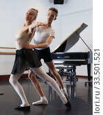 Купить «Ballet partners dancing gracefully together in the ballet studio», фото № 33501521, снято 26 апреля 2019 г. (c) Яков Филимонов / Фотобанк Лори