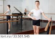 Купить «Positive teenager practicing at the ballet barre», фото № 33501545, снято 26 апреля 2019 г. (c) Яков Филимонов / Фотобанк Лори