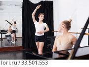Купить «Female choreographer teaches young dancer in ballet studio», фото № 33501553, снято 26 апреля 2019 г. (c) Яков Филимонов / Фотобанк Лори