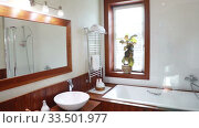 Купить «Modern Residential Home Bathroom with large mirror and window», видеоролик № 33501977, снято 6 апреля 2020 г. (c) Алексей Кузнецов / Фотобанк Лори